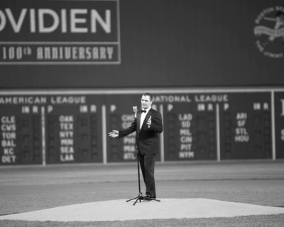 """Brian Evans films his music video """"At Fenway"""" in September 2012, the first solo artist ever to film a music video entirely at Fenway Park in its history. William Shatner portrays the home plate umpire in the video. (PRNewsFoto/H Infinity Books)"""