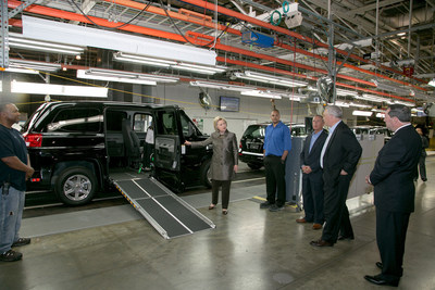 """Right to left - (Indiana Sen. Joe Donnelly AM General President and CEO, Andy Hove, AM General, Commercial President, Howard Glaser and Mrs. Clinton.)Upon seeing a demonstration of the MV-1 vehicle by Mobility Ventures employee, and former Ms. Wheelchair America, Erika Bogan, Mrs. Clinton commented later to a gathered crowd, """"I want to thank you for coming up with the MV-1. What a remarkable invention, providing dignity, mobility to people with disabilities. I am thrilled that I got to see that."""""""