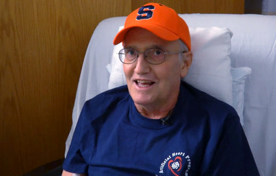 Syracuse University basketball fan Ron Fontana wears the colors as he awaits his discharge from Strong Memorial Hospital. The SynCardia Total Artificial Heart, powered by the Freedom(R) portable driver, is keeping him alive as he waits for a matching donor heart transplant. (PRNewsFoto/SynCardia Systems, Inc.)