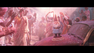 Starring in Travelocity's new ad campaign the Roaming Gnome finds himself being handed off from one person to the next at the Holi Festival in India.