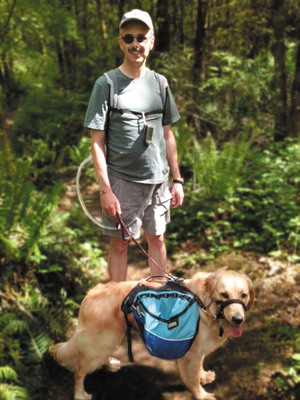 Chris Marshall hiked 607 miles while waiting for his donor heart using the Freedom portable driver to power his SynCardia Total Artificial Heart. Mr. Marshall, pictured with his dog Gracie, received his donor heart transplant on Sept. 12, 2012 and is doing well.  (PRNewsFoto/SynCardia Systems, Inc.)