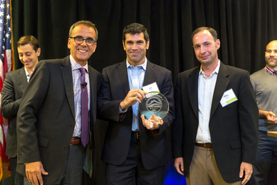 Matterport was named as the grand prize winner of the second annual Realogy 'FWD' Innovation Summit held in Madison, New Jersey. Pictured (l-r) are: Alex Perriello, chief executive officer, Realogy Franchise Group; and from Matterport, Bill Brown, chief executive officer and Mike Beebe, co-founder and chief operating officer. Matterport's computational photography technology enables rapid high-quality 3D visualization of physical spaces, which encompasses individual room-level views...