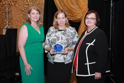 Amy Scott (center), director of product development purchasing - FCA US, accepts the Corporation of the Year award from the Great Lakes Women's Business Council President Sandra Miller (left) and Executive Director Michelle Richards (right) on Thursday, April 21, 2016. The award acknowledges the Company's support and development of minority- and women-owned businesses in Michigan and Indiana...