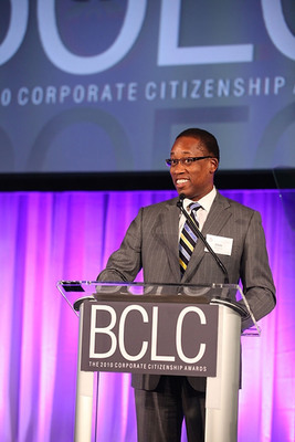 Chris Simmons, Market Managing Partner at PwC, accepts the BCLC's Corporate Citizenship Award for US Community Service on behalf of the firm.