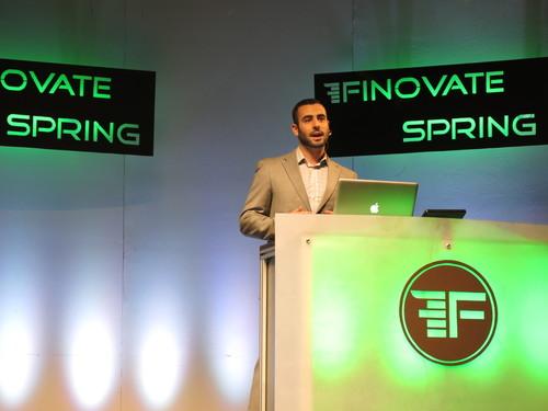 Interactions' Dan Fox presenting on stage at FinovateSpring 2014 (PRNewsFoto/Interactions Corporation) ...