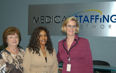 Medical Staffing Network CNO Patrica Layton, RN (L) and VP of Human Resources Kim Jones (R) present Valentine Amousse, RN (C) with Nurse of the Month Award.  (PRNewsFoto/Medical Staffing Network Healthcare, LLC)