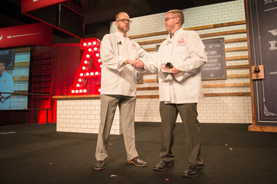 Arby's Corporate Executive Chef, Neville Craw (left), presents the Hey Chef Neville! award to team member, Brandon Morris (right), of Danville, Kentucky at Arby's 2014 Worldwide Franchise Convention in Las Vegas. Morris submitted the winning idea for the King's Hawaiian Fish Deluxe Sandwich, which is being featured at Arby's restaurants nationwide this month as a special menu item. Morris was presented with a trophy, $1,500 check and a custom-made chef coat.