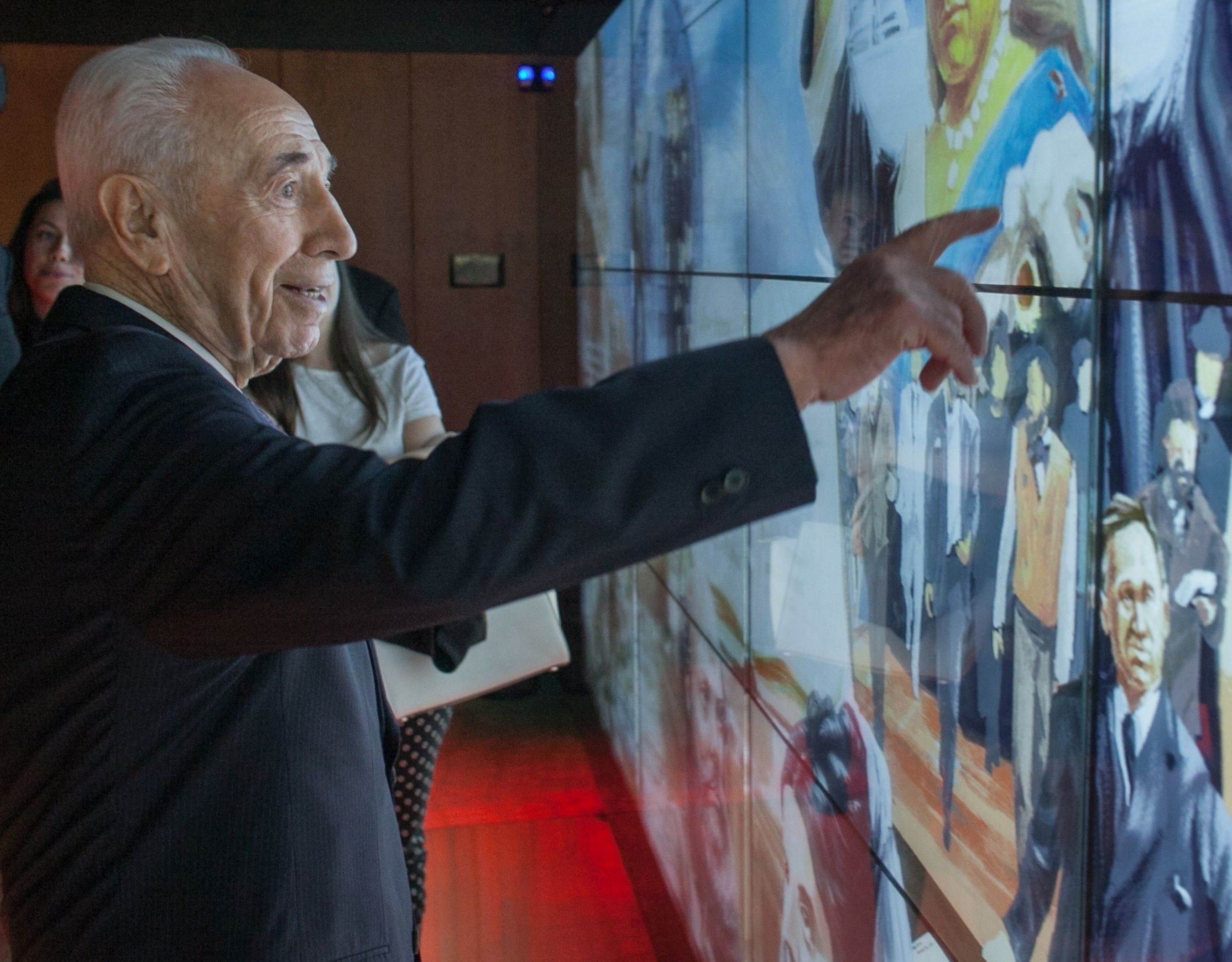 Former Israeli President Shimon Peres, International Chairman of the Friends of Zion (FOZ) Museum in Jerusalem, activating a historical figure on the largest interactive mural in Israel, located at the museum, honoring non-Jews who support Israel and the Zionist vision.