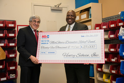 Stanley M. Bergman, Chairman of the Board and Chief Executive Officer of Henry Schein, presents Charles Redding, Chief Executive Officer and President of MedShare, with a $25,000 donation to become the first corporate sponsor of MedShare's newly created Disaster Relief Fund.