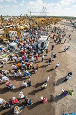 A crowd of bidders gather around the gigantic line-up of excavators at the Ritchie Bros. permanent auction site in Orlando, FL on Day Three (February 20, 2014) of the six-day auction  February 17  22, 2014 (PRNewsFoto/Ritchie Bros. Auctioneers)