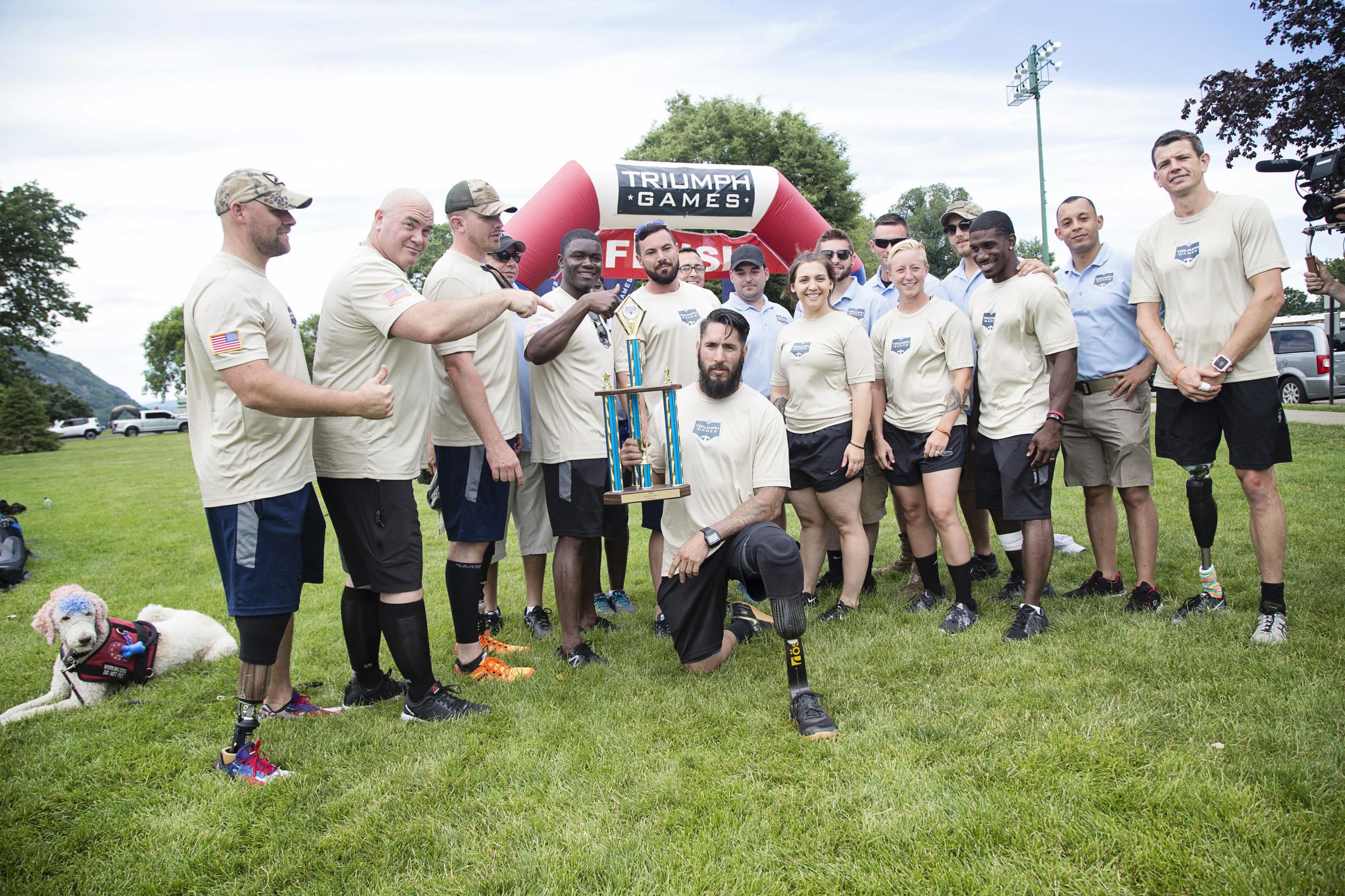 2016 Triumph Games team celebrate with champion, Michael Gallardo
