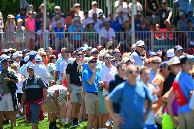 Spectators take in the action on the first tee during the Meijer LPGA Classic for Simply Give at Blythefield Country Club.