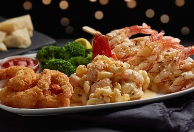 Red Lobster's NEW! Wild-Caught Lobster-and-Shrimp Trio features a wood-grilled Maine lobster tail topped with Norway lobster mac-and-cheese, paired with a garlic-grilled red shrimp skewer and panko-crusted red shrimp with Red Lobster's classic cocktail sauce.
