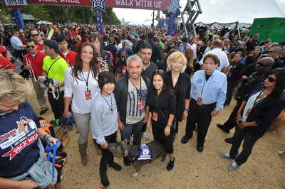 Cesar Millan, center, and National Pack Walk partners gear up to lead the Second Annual National Family Pack Walk on Saturday Sept. 29, 2012, in Washington.(PRNewsFoto/Larry French/Invision for Warner Bros. Consumer Products/AP Images)