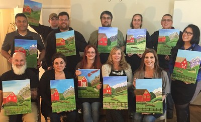 A group of wounded veterans and their guests share time and talent while painting.