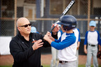 Baseball legend and Transitions adaptive lenses wearer Cal Ripken, Jr. teamed up with Transitions Optical to make healthy, enhanced vision a reality for hundreds of children in-need across the country.  (PRNewsFoto/Transitions Optical, Inc.)