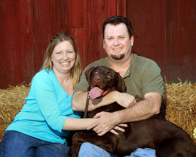 Ronda and Michael Oliver enjoy a happy moment with their chocolate Labrador retriever, Weston. Because of the SynCardia Total Artificial Heart, Michael was there to care for his wife during her own medical crisis.  (PRNewsFoto/SynCardia Systems, Inc.)
