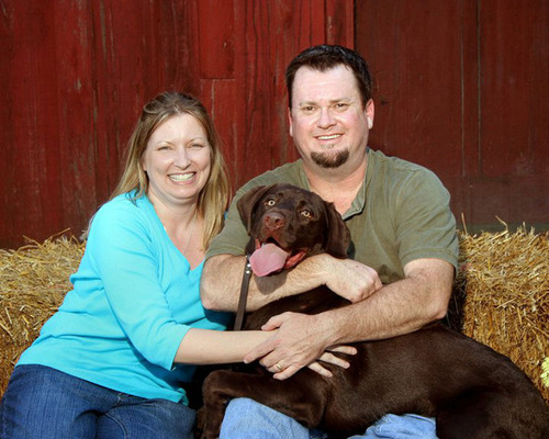 Ronda and Michael Oliver enjoy a happy moment with their chocolate Labrador retriever, Weston. Because of the SynCardia Total Artificial Heart, Michael was there to care for his wife during her own medical crisis. (PRNewsFoto/SynCardia Systems, Inc.) (PRNewsFoto/SYNCARDIA SYSTEMS, INC.)