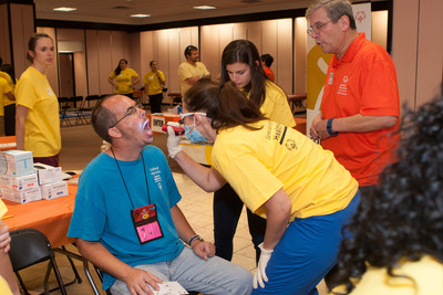 Special Olympics' Special Smiles dental exams, Dr. Michael Milano (r), courtesy Special Olympics North Carolina