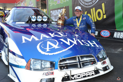 Mopar driver Tommy Johnson Jr. earns NHRA Funny Car win at Bristol Dragway in DSR Dodge Charger R/T (PRNewsFoto/Chrysler Group LLC)