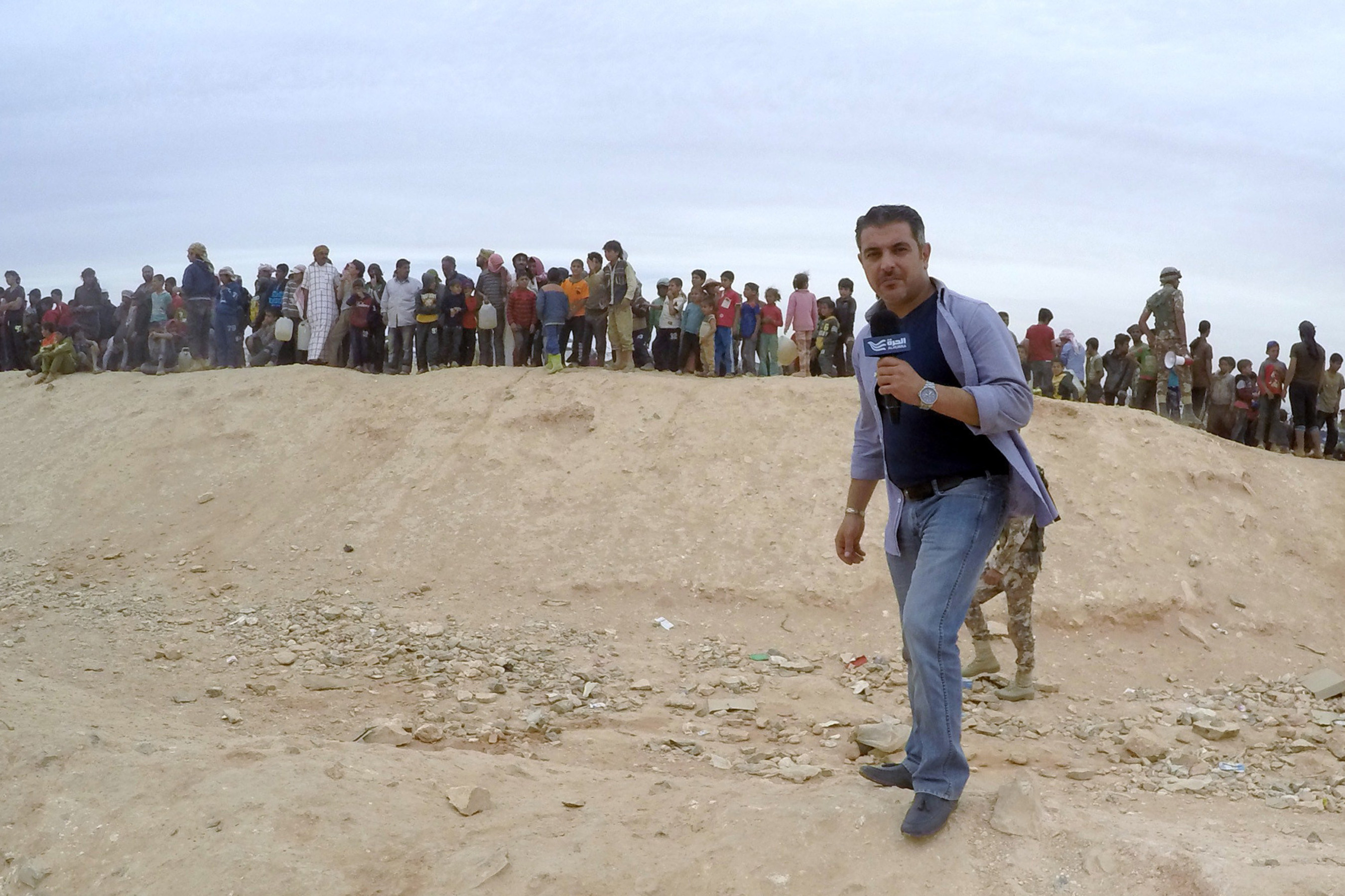 Alhurra reporter along the Jordanian border, covering the Syrian refugee crisis