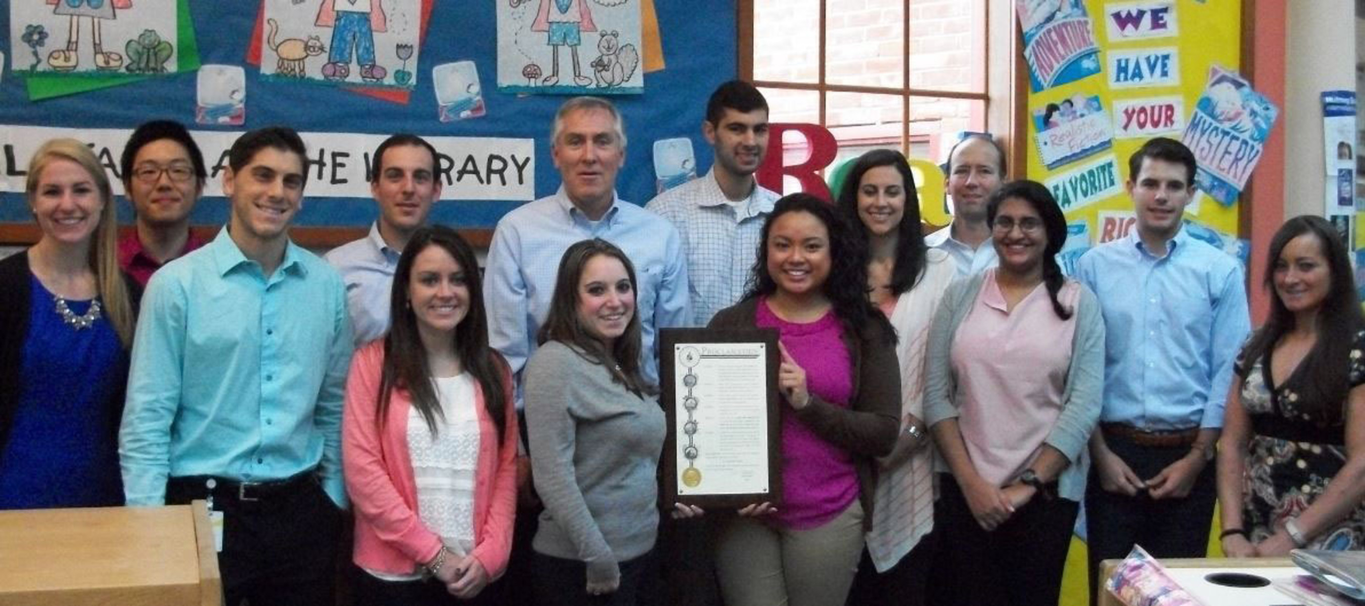 EY Stamford Office Managing Partner, Bud McDonald along with EY professionals volunteering for Junior Achievement