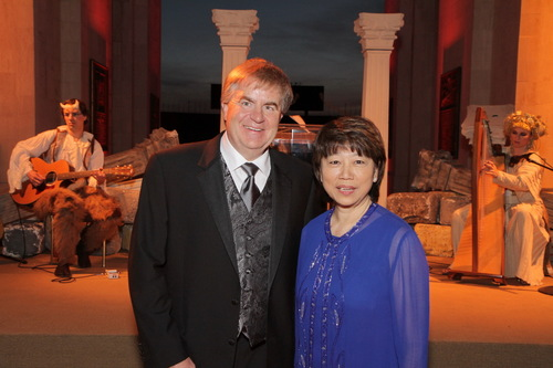 Gala co-chairs Robert S. Carter, Senior Vice President - Automotive Operations of Toyota Motor Sales, U.S.A., and Anne Shen Smith, past Chairman and CEO of Southern California Gas Company, preside over the California Science Center's 2014 Discovery Ball program during the gala's Romanesque feast at the Los Angeles Memorial Coliseum's peristyle. (PRNewsFoto/California Science Center)