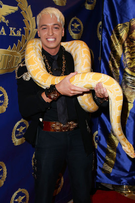 KUBA Ka with his pet snake Zeus