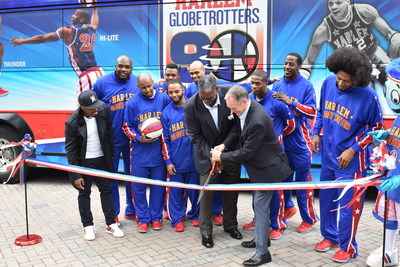 The world famous Harlem Globetrotters officially opened the doors to their new corporate offices in Atlanta today. On hand during the ribbon cutting ceremony were the Globetrotters stars, team President Howard Smith, the team's director of player personnel Sweet Lou Dunbar, and Teddy Riley (far left).