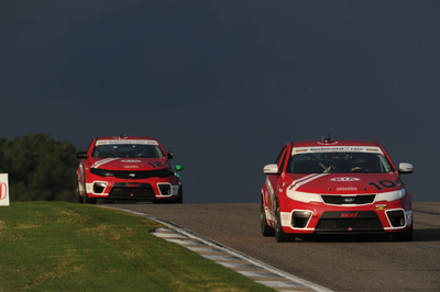 Kia Racing's Infinity Audio Forte Koups finish second and ninth in round two of the Continental Tire Sports Car Challenge at Barber Motorsports Park.  (PRNewsFoto/Kia Motors America)