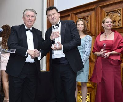Sir Paul Judge, AMBA President, presents the 2014 MBA Innovation Award to Dr. Stephen Hodges, President of Hult International Business School, at the Association of MBAs' Awards & Gala Dinner, held at the Royal Institute of British Architects on October 30, 2014.