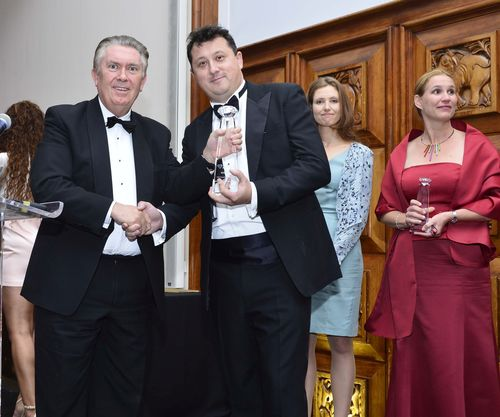 Sir Paul Judge, AMBA President, presents the 2014 MBA Innovation Award to Dr. Stephen Hodges, President of Hult International Business School, at the Association of MBAs' Awards & Gala Dinner, held at the Royal Institute of British Architects on October 30, 2014. (PRNewsFoto/Hult International)