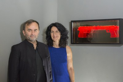 """Mr. Patrick Desbois, president and founder of Yahad-In Unum, standing with Israel artist Mira Maylor, whose art is featured in the exhibit """"Memory of the Holocaust Through Art,"""" at the Museo de Holocausto, founded by Yahad-In Unum, in Guatemala."""