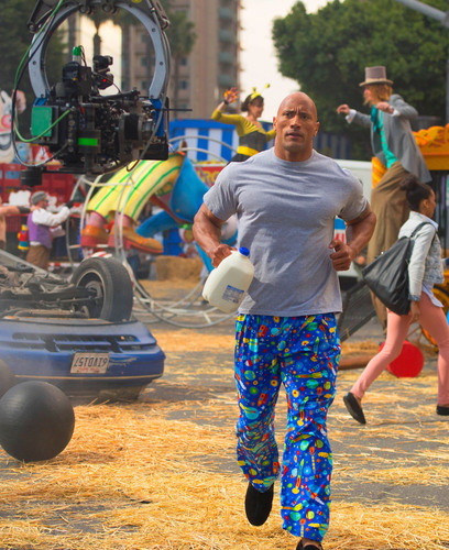"Dwayne ""The Rock"" Johnson runs through the set of the first-ever got milk?(R) Super Bowl TV commercial that puts the focus on getting protein in the morning.   (PRNewsFoto/National Milk Mustache 'got milk?(R)' Campaign)"