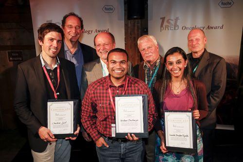Jury and proud prize winners (from left to right): Christian Jost (2nd prize), Gerhard Niederfellner, Klaus Bosslet, Krishna Chaitanya (1st prize), Hans-Peter Altevogt, Vineeta Bhasker Tripathi (3rd prize), Winfried Welz. (PRNewsFoto/Roche Diagnostics GmbH)