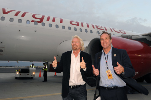 Virgin Group Founder Sir Richard Branson and Palm Springs Mayor Steve Pougnet pose in front of a Virgin America Airbus A319 aircraft at Palm Springs International Airport after Virgin America's first flight to Palm Springs from San Francisco in December 2011.  (PRNewsFoto/Virgin America)