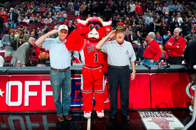 "Father and son U.S. Army veterans Edward and Jerry Pasierb were honored at the Nov. 8, 2012 Chicago Bulls game through BMO Harris Bank's ""Military Moments"" program.  (PRNewsFoto/BMO Harris Bank)"