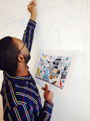 A SCAD student sketches his design on the wall of Newell Rubbermaid's new Sharpie(R) brand headquarters, which will become part of permanent art installation. (PRNewsFoto/Savannah College of Art and Design)