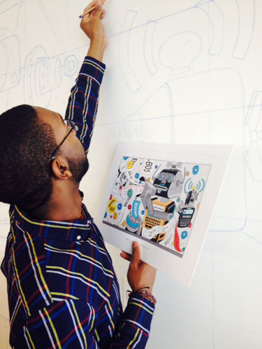 A SCAD student sketches his design on the wall of Newell Rubbermaid's new Sharpie(R) brand headquarters, ...