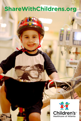 Lex Money, a patient at Children's Healthcare of Atlanta, rides a tricycle through the halls of the Children's Cardiac Step-down Unit.