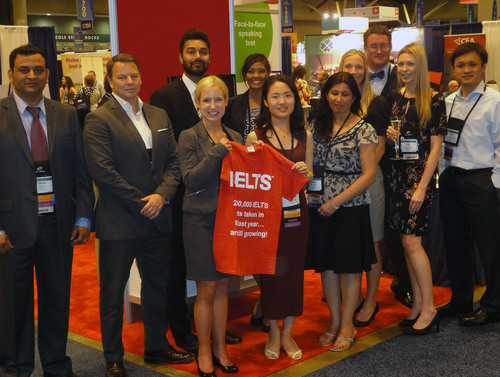 IELTS staff celebrates 2 million tests taken at NAFSA 2013.  (PRNewsFoto/IELTS USA)