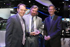 """Ezra Dyer, automotive editor, Popular Mechanics, presents the Popular Mechanics """"Luxury Car of the Year"""" award to Dave Zuchowski, president and CEO, Hyundai Motor America (center) and Mike O'Brien, vice president, corporate and product planning, Hyundai Motor America."""