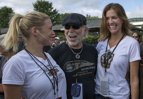 Pictured from left to right, actress Katee Sackhoff (co-star of the upcoming feature film Riddick), Willie G. Davidson (grandson of Harley-Davidson co-founder William A. Davidson) and actress Tricia Helfer (co-star of ABC's 'Killer Women') share a laugh before the start of the Harley-Davidson 110th Anniversary parade in Milwaukee.  The stars joined nearly 7,000 fellow Harley-Davidson enthusiasts in the company's hometown to parade about five miles through the downtown streets, while tens of thousands of local residents cheered ...