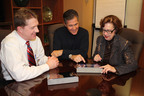 Pictured are Darryl Duncan, President & CEO, Glenn Adrian, Chairman of the Mon Health System Board of Directors and Sarah Minear, Chair of the Mon General Hospital Board of Directors using Diligent Boardbooks for the iPad.  (PRNewsFoto/Diligent Board Member Services, Inc)