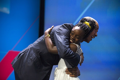 US President Barack Obama hugs 11-year-old Mikailia Ulmer who introduced him at the first-ever United State of Women Summit at the Walter E. Washington Convention Center in Washington, DC, USA, 14 June 2016. Attendees also included the First Lady Michelle Obama and TV personality Oprah Winfrey.  EPA/JIM LO SCALZO