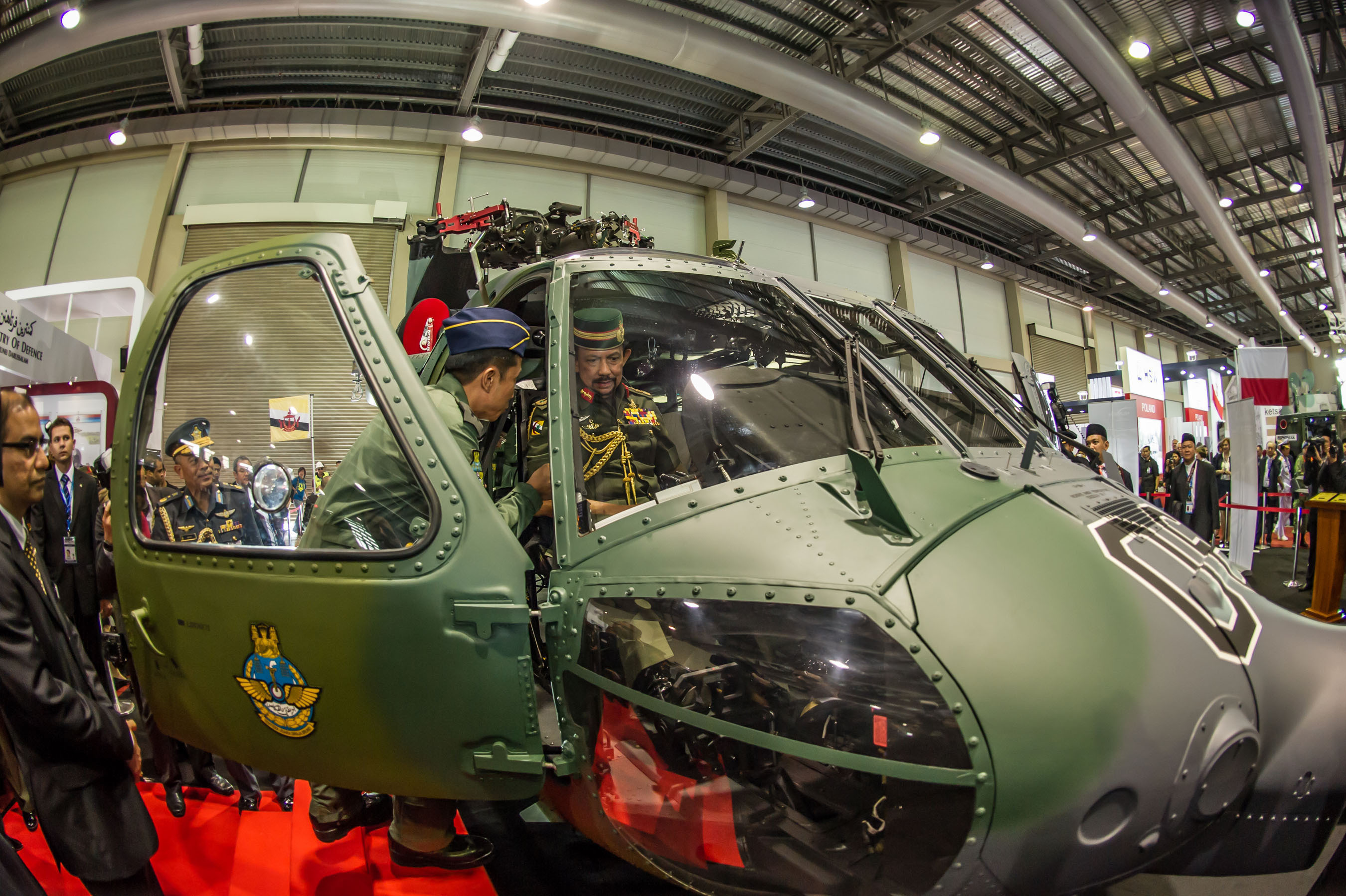 The Sultan of Brunei inspects a Sikorsky S-70i(TM) BLACK HAWK helicopter during the Brunei International Defence Exhibition. The Royal Brunei Air Force is taking delivery of 12 S-70i aircraft through the end of 2014. Equipped with a suite of advanced avionics and sensors, the multirole aircraft will perform a variety of missions over land and water, including search and rescue, humanitarian relief, anti-piracy, troop transport and medical evacuation. (PRNewsFoto/Sikorsky Aircraft) (PRNewsFoto/SIKORSKY AIRCRAFT)
