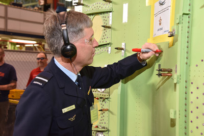 RAAF Air Commodore Adam Brown visited Spirit to see the inline modifications on the first Australian P-8A. During his visit he signed his name on the fuselage of the first Australian P-8A.