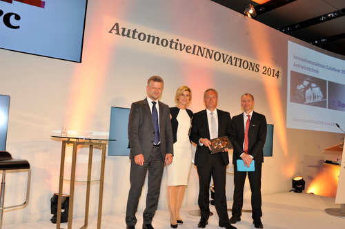 Frederic Lissalde, President and General Manager, BorgWarner Turbo Systems (third from the left), accepts the AutomotiveINNOVATIONS Award 2014 from Dr. Christoph Skudelny, Automotive Practice Leader, PricewaterhouseCoopers (left), Prof. Dr. Stefan Bratzel, Director CAM (right) and moderator Barbara Hahlweg (second from left). (PRNewsFoto/BorgWarner Inc.)