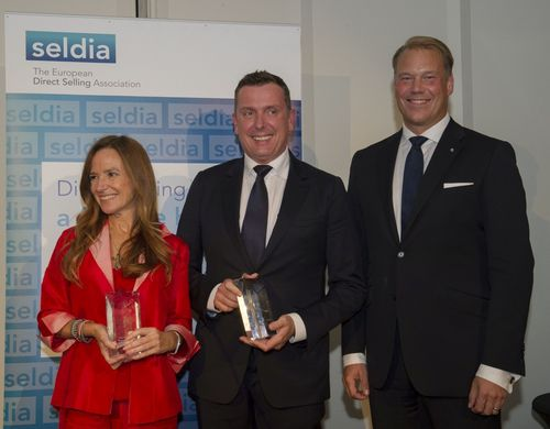 Awarded an ASTRA from SELDIA:Teresa Jimenez, Spanish member of the European Parliament (left), MartinKohler, ...