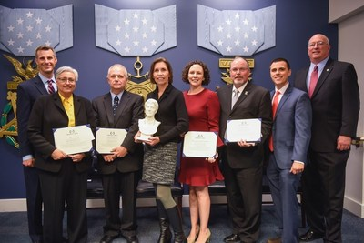 Newman's Own Jeffrey Smith with the winners and sponsors of the 17th Annual Newman's Own Awards Ceremony at the Pentagon Hall of Heroes with Mary Catherine Valdez, Project Mend; Robert (Bob) Curry, Dryhootch of America, Inc.; Barbara Van Dahlen, Give an Hour; Josie Beets, Military Spouse JD Network Foundation; Bill Robinson, FITSI Foundation; Tony Lombardo, Military Times; and Dave Coker, Fisher House Foundation, in Washington. Newman's Own joined co-sponsors Fisher House Foundation and Military Times to honor five non-profit organizations for their innovative programs created to improve military quality of life military quality of life. (Kevin Wolf/AP)